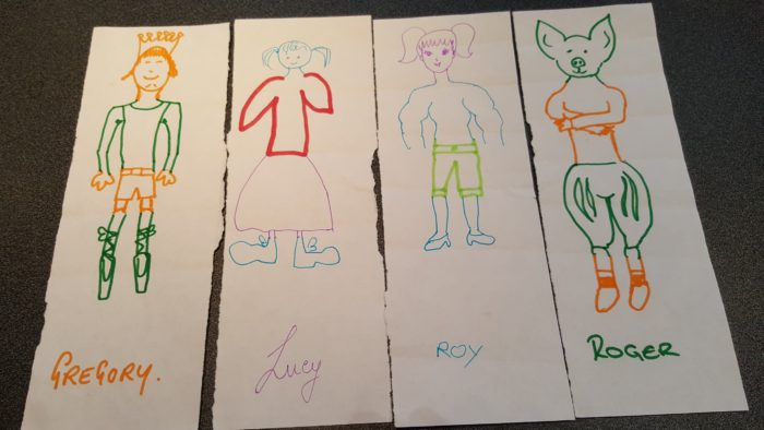 Children's drawings of people created by different children adding parts to the picture