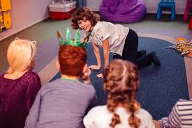An indoor children's game of charades