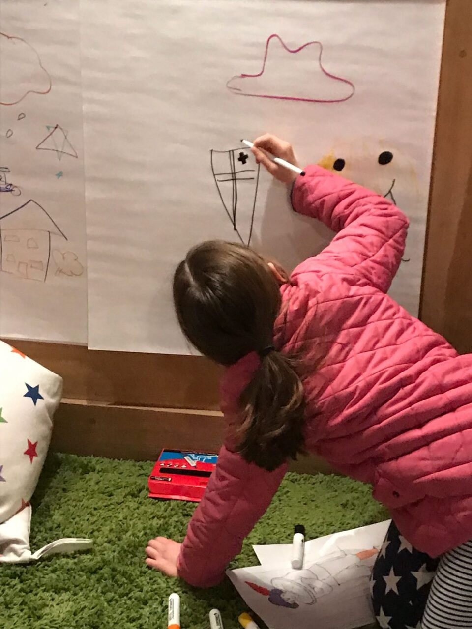 A child drawing a picture of a shield